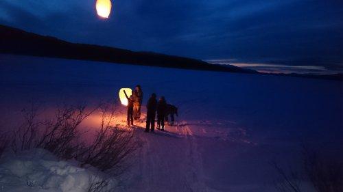 Floating chinese lanterns over frozen Yukon lake