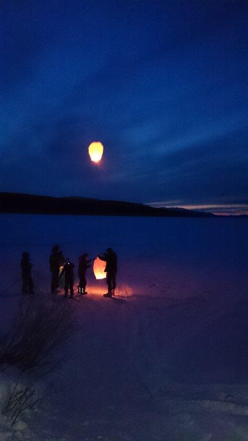 Bright chinese lanterns released in Yukon wilderness