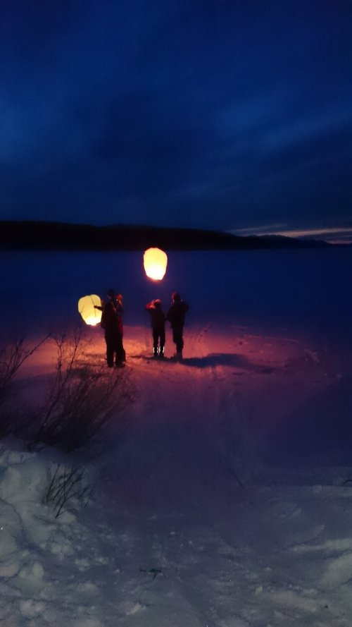 Chinese lanterns released from frozen lake