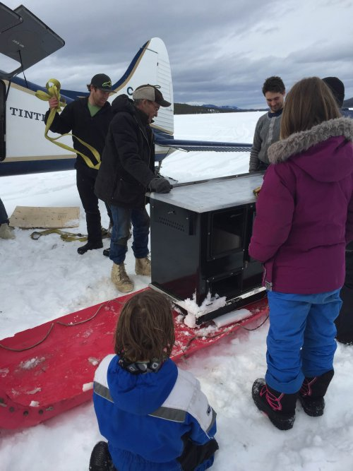 Stove loaded on sled for transport