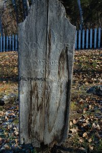Weathered old headstone in the Freemason Cemetary, Dawson City, Yukon