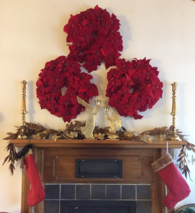Holiday Wreaths Above the Fireplace